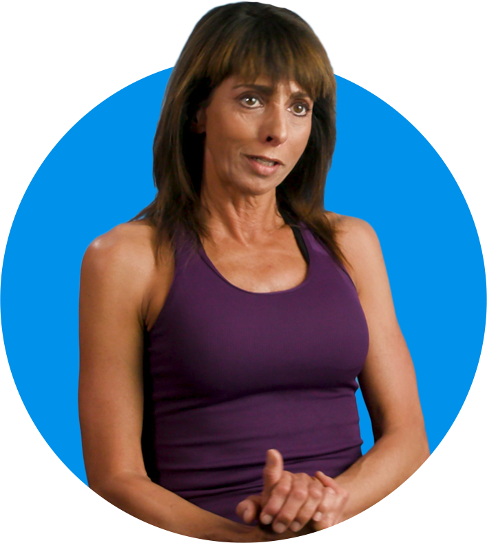 Woman with hands clasped, wearing a tank top