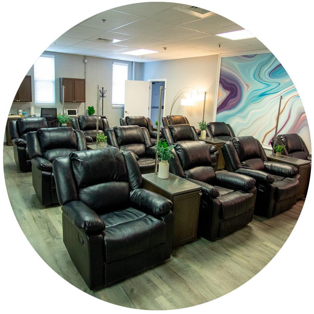 Rows of padded armchairs inside the Confidia IV Therapy Lounge