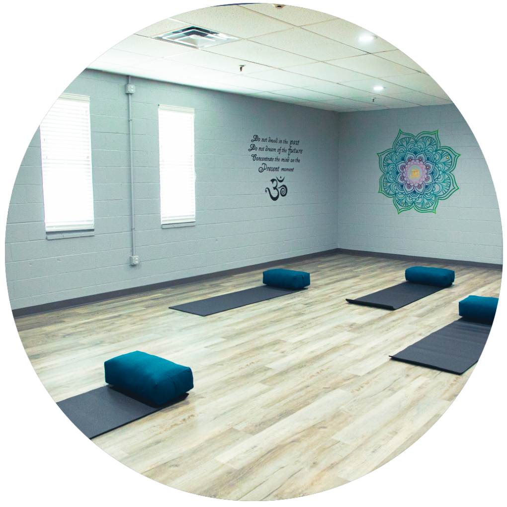 Interior view of the Yoga studio at the Confidia Health Institute location in Bristol Connecticut, with yoga mats and pillows on the floor